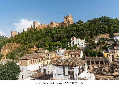 Alhambra fortress from a distance overlooking courtyards.  Alhambra from a distance overlooking Albaicin.