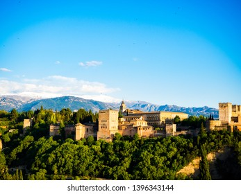 the alhambra of granada with sierra nevada in the background