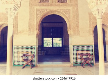 Alhambra palace, Granada, Andalusia. Image filtered in faded, washed out, retro style; nostalgic, vintage travel concept.