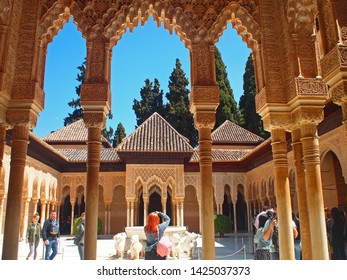 Alhambra Palace, Granada, Andalusia, Spain - 13 April 2019 :  View of The Court of the Lions (Patio de los Leones),  the main courtyard of the Nasrid dynasty Palace of the Lions in The Alhambra