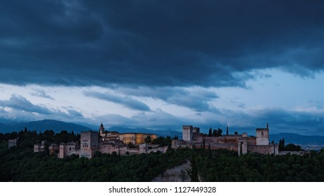 Alhambra panoramic scenic view with blue cloudy sky at sunshine in Granada. Andalucia, Spain.