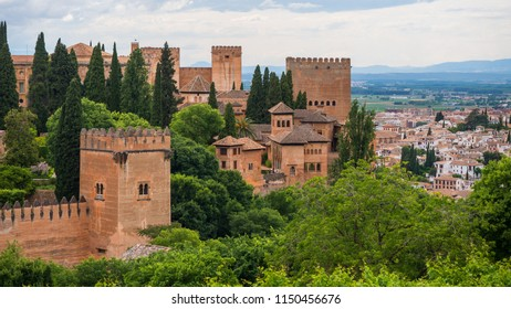 Alhambra panoramic scenic view with blue cloudy sky in Granada. Andalucia, Spain.