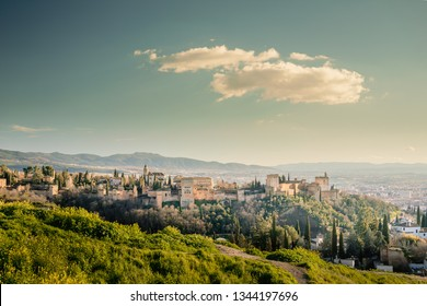 Alhambra panoramic scenic view with blue cloudy sky in Granada. Andalucia, Spain
