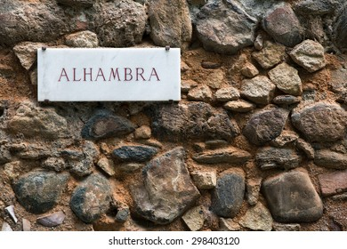 Alhambra sign on ancient wall