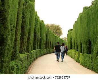 ALHAMBRA, SPAIN - SEPTEMBER 28, 2009: Curved pathway in the famous gardens of Alhambra, Spain