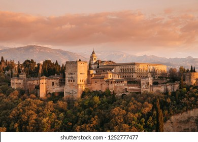 Alhambra in the sun set light with the Siera Nevada in background