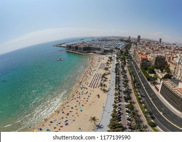 Alicante  aerial wide angle photo over looking the beautiful town of Alicante in Spain taken with a drone lover looking the beautiful beach on a clear day showing the beach, sunbathers, road, hotels