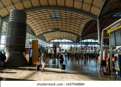 Alicante Airport, Spain - 28 June 2019 : people hurrying around in airport departure area at Alicante terminal check-ins