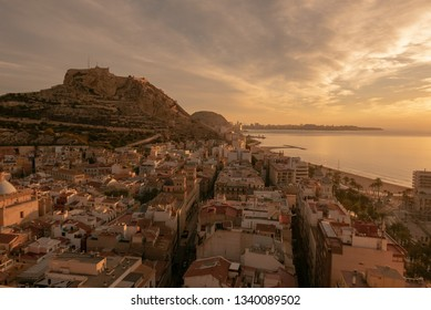 Alicante, Castle of Santa Barbara on Mount Benacantil at dawn and mediterranean sea