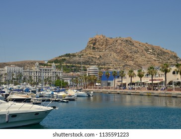 Alicante harbour, luxury yachting marina with Mount Benacantil, famous tourist attraction in background. Alicante city, Spain, Europe. July 2018