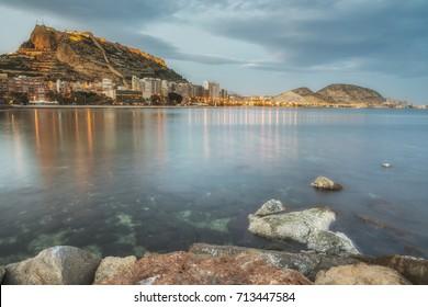 Alicante with the Santa Barbara castle at the dusk from the sea, Costa Blanca, Valencia province. Spain.