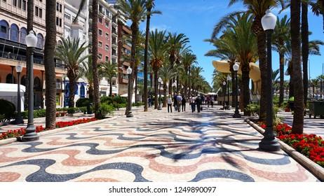 Alicante/ Spain - 05/16/2018: Main street by the sea in Alicante, promenade, street with palm trees by the sea - Esplanada