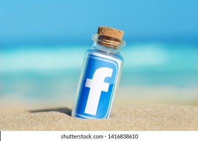 Alicante, Spain - August 31, 2016: Facebook, Instagram printed on paper and placed in the sand against the sea.