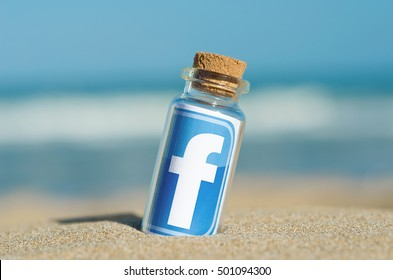 Alicante, Spain - August 31, 2016: Facebook like logo for e-business, web sites, mobile applications, banners, printed on paper and placed in the sand against the sea Social network facebook sign.