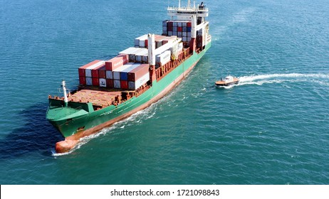 ALICANTE, SPAIN – FEBRUARY 6, 2020. Aerial view of the container ship AVera maneuvering for boarding the pilot cutter before arrival to the port of Alicante.
