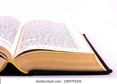 Alicante, Spain - February 8, 2019: Opened hebrew Bible, isolated on white background