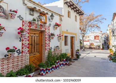 ALICANTE, SPAIN- JANUARY 18, 2018: Colored picturesque houses, street.Typical neighborhood historic center, casco antiguo,barrio santa cruz.Alicante, Spain.
