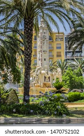 ALICANTE, SPAIN - JULY 1, 2019: Alicante Plaza de los Luceros (Placa dels Estels) - compact town square featuring an ornamental monument and Levante fountain. Alicante, Valencia province, Spain.