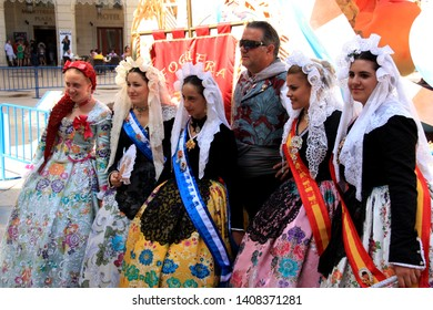 Alicante, Spain - June 22nd 2012: Traditionally dressed up people at the Hogueras de San Juan Festival in Alicante, Spain, posting for a picture