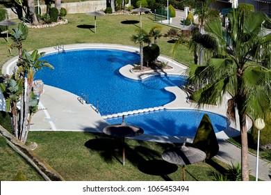 Alicante, Spain - March 05, 2018: Swimming pool and green lawn. Alicante province, Spain