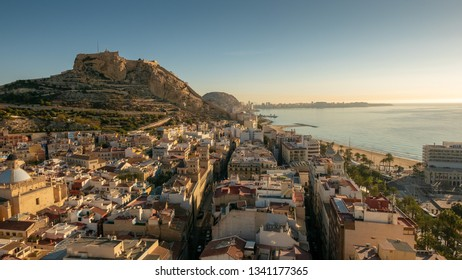 ALICANTE, SPAIN - MARCH 12, 2019: Alicante, Castle of Santa Barbara on Mount Benacantil at dawn and mediterranean sea