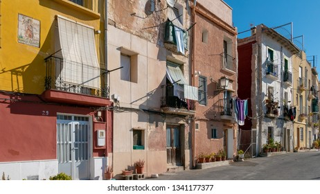 ALICANTE, SPAIN - MARCH 12, 2019: the popular neighborhood of Santa Cruz, next to the Castillo de Santa Barbara, in Alicante, Spain