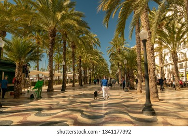 ALICANTE, SPAIN - MARCH 12, 2019: pedestrians in the busy esplanade of Spain, in Alicante. Sunny day