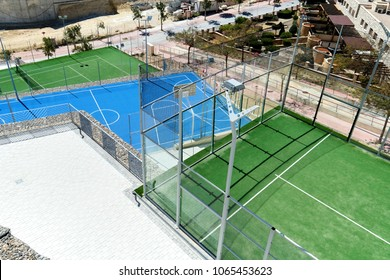 Alicante, Spain - March 24, 2018: Tennis and basketball courts, view from above. Spain