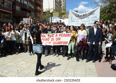 ALICANTE, SPAIN - MARCH 27, 2014: Protest demonstration of university students and college students in Alicante  Alicante - city in  Valensiysky Autonomous Region, capital of the Province of Alicante.