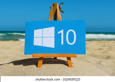 Alicante, Spain - September 01, 2016: Windows 10 logo printed on paper and placed on wooden easel against the sea.  Windows 10 the operating system developed by Microsoft.