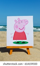 Alicante, Spain - September 01, 2016: Peppa Pig   printed on paper and placed on wooden easel against the sea.  Peppa Pig is a cartoon character produced by the UK animations.