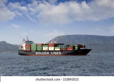 "ALICANTE, SPAIN - SEPTEMBER 10: The containership ""Beatriz B"" of Boluda Lines Ships wait anchored to enter in the port of Alicante, on September 10, 2013 in Alicante."