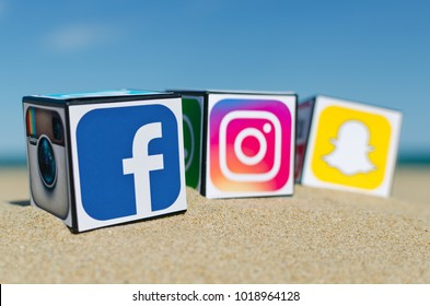 Alicante, Spain - September 15, 2016: Cubes with logotypes of social media: Facebook,  Instagram, Snapchat  placed in the sand against the sea.