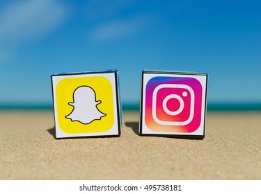 Alicante, Spain - September 15, 2016: Cubes with logotypes of social media: Instagram, Snapchat  placed in the sand against the sea.
