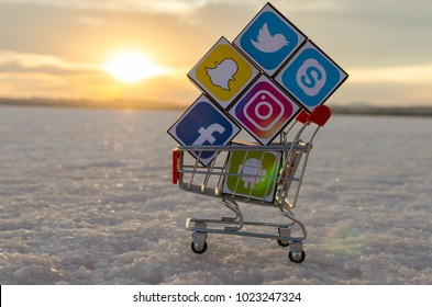 Alicante, Spain - September 17, 2016: Cubes with logotypes of social media: Facebook, Twitter, Instagram, Snapchat,  Android, Skype placed into shopping cart on the sunset.