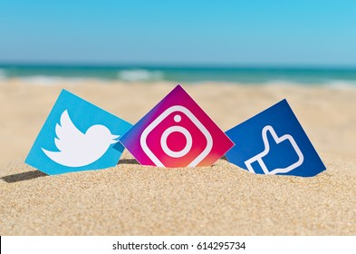 Alicante, Spain - September 19, 2016:  Popular social media Twitter,Instagram and Facebook printed on paper and placed in the sand against the sea.