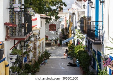 Alicante, Spain - September 24 The neighborhood Santa Cruz in the city Alicante, at the Costa Blanca, Spain on September 24, 2015. The neighborhood is famous for its traditional white houses.