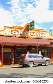 ALICE SPRINGS, AUSTRALIA - December 6. People walk along the Saloon, an Australian pub and food restaurant in the city center on December 6, 2015 in Alice Springs.