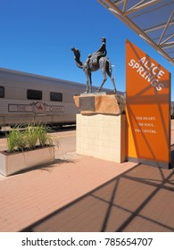 Alice Springs, Australia - September 7, 2017: The famous Ghan railway at the Alice Springs terminal with a local sign