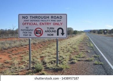 ALICE SPRINGS, NT - MAY 20 2019:Warning sign on the road to Pine Gap.Pine Gap is a satellite surveillance base near Alice Springs in the Northern Territory of Australia.