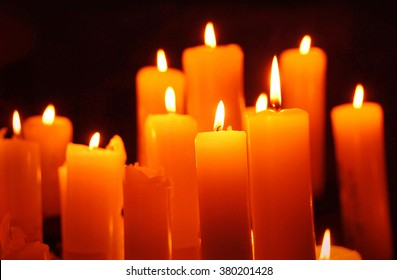 Alight candles on black, easter greeting card