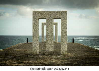 Aligned monuments over a seascape background, Garachico, Tenerife, Spain.