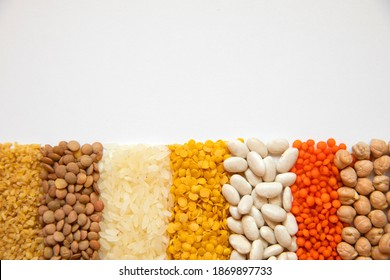 Aligned some legumes, red lentil, dry chickpeas, beans, bulgur wheat, rice and yellow lentils.
