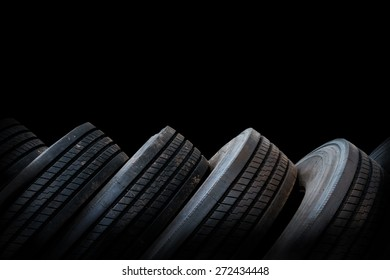 alignment of car tires in black background, used tires
