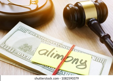 Alimony on a court desk. Divorce and separation concept