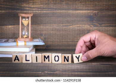 alimony. wooden letters on the office desk, informative and communication background