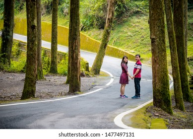 Alishan National Scenic Area, Chiayi Province, Taiwan, 20 July 2019: couple go to the forest at Alishan national park.