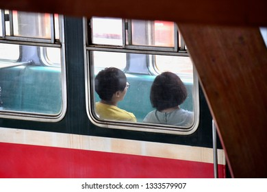 ALISHAN NATIONAL SCENIC AREA, TAIWAN - OCTOBER 1,2018: The passenger on the old famous train route to the Alishan national scenic by see through train's mirror frame, Chiayi