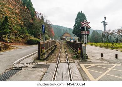 ALISHAN, TAIPEI. DEC 28, 2017: Train rail with railway traffic lights in Alishan Forest Railway in Alishan, Taiwan.