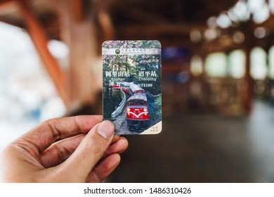 ALISHAN, TAIPEI. DEC 28, 2017: Hand holding Alishan Forest Railway ticket from Alishan to Zhaoping station in Alishan, Taiwan.
